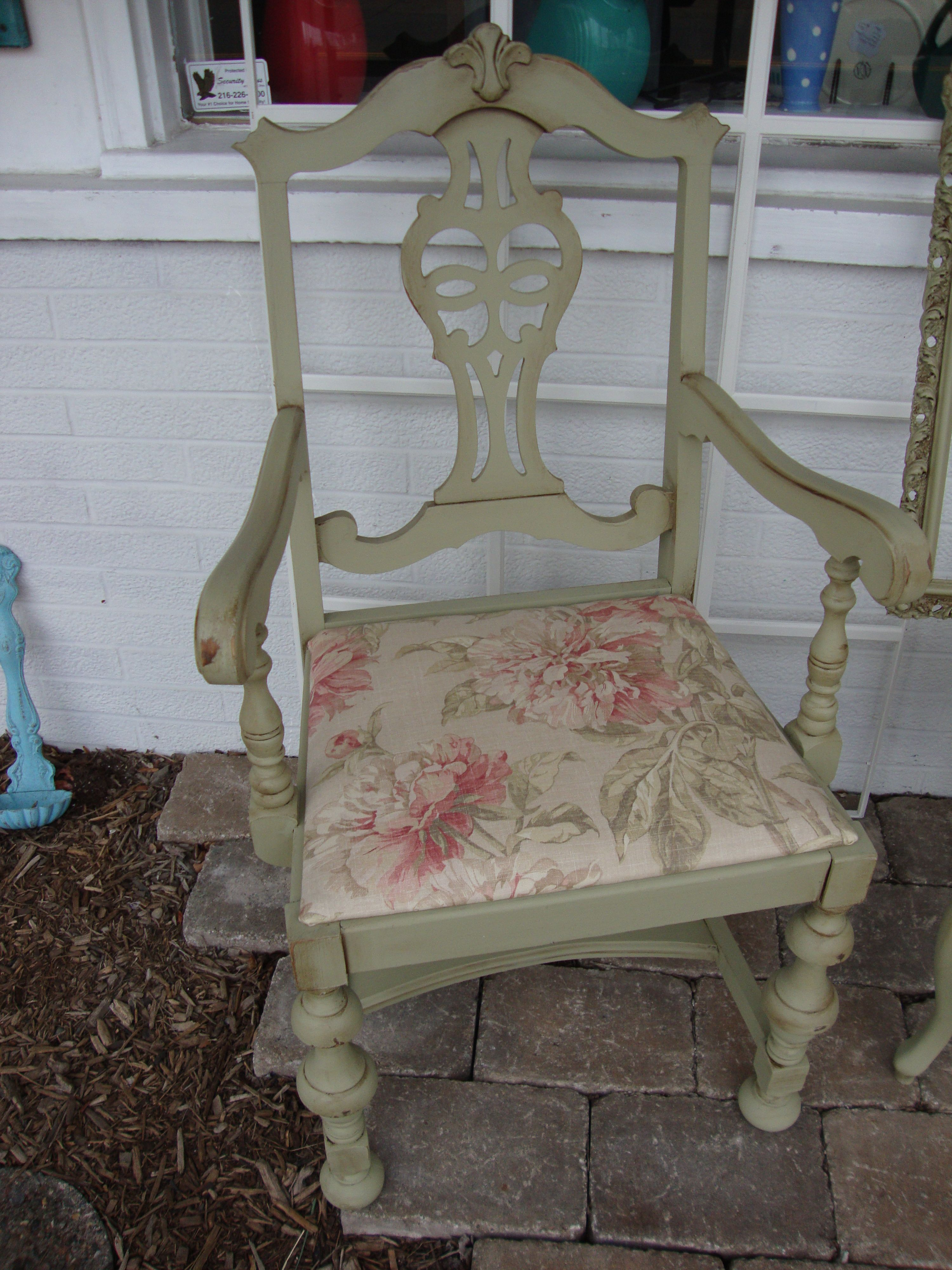 This Captain's chair was painted in sage and glazed in brown.  The seat was recovered in a faded floral fabric.