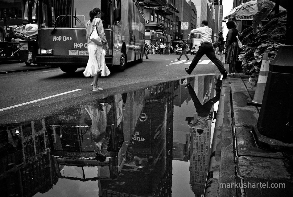Markus Hartel Untitled I Think This Image Captures A Decisive - Photographer captures the amazing reflections of puddles in new yorks streets