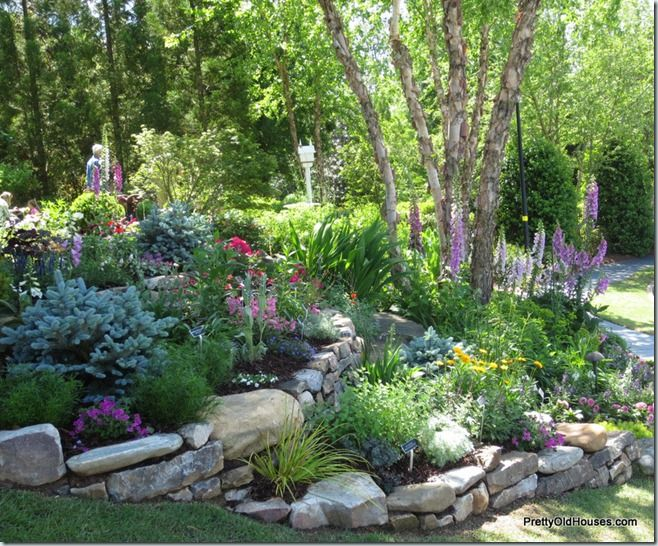 Terraced flower beds for the garden pinterest flower for Rock flower garden ideas