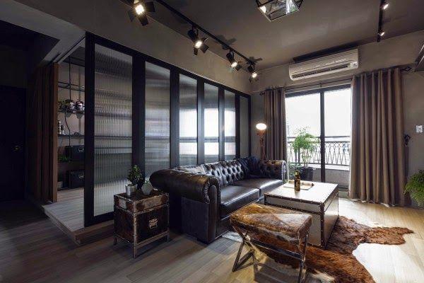 Apartamento industrial inspirado en los superheroes de Marvel Deco - paredes de cemento