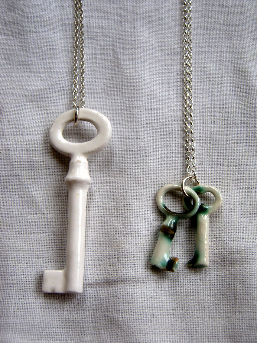 Porcelain sterling silver key necklaces from Katherine Lees Ceramics Cast from Victorian pass keys (keys that open more than one door) these ornate ceramic keys are symbols for luck, wealth and trust.