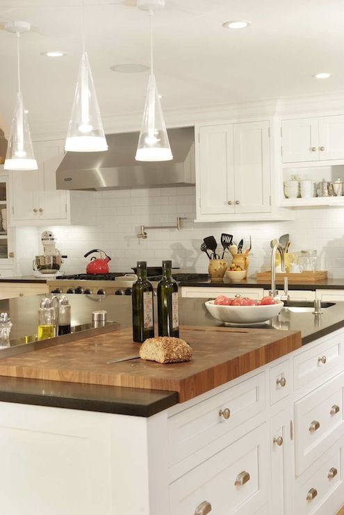Spacious And Stylish Kitchen Design With Generous White Shaker Cabinents Built Into Butcher Block Island Kitchen Kitchen Island With Sink Kitchen Inspirations