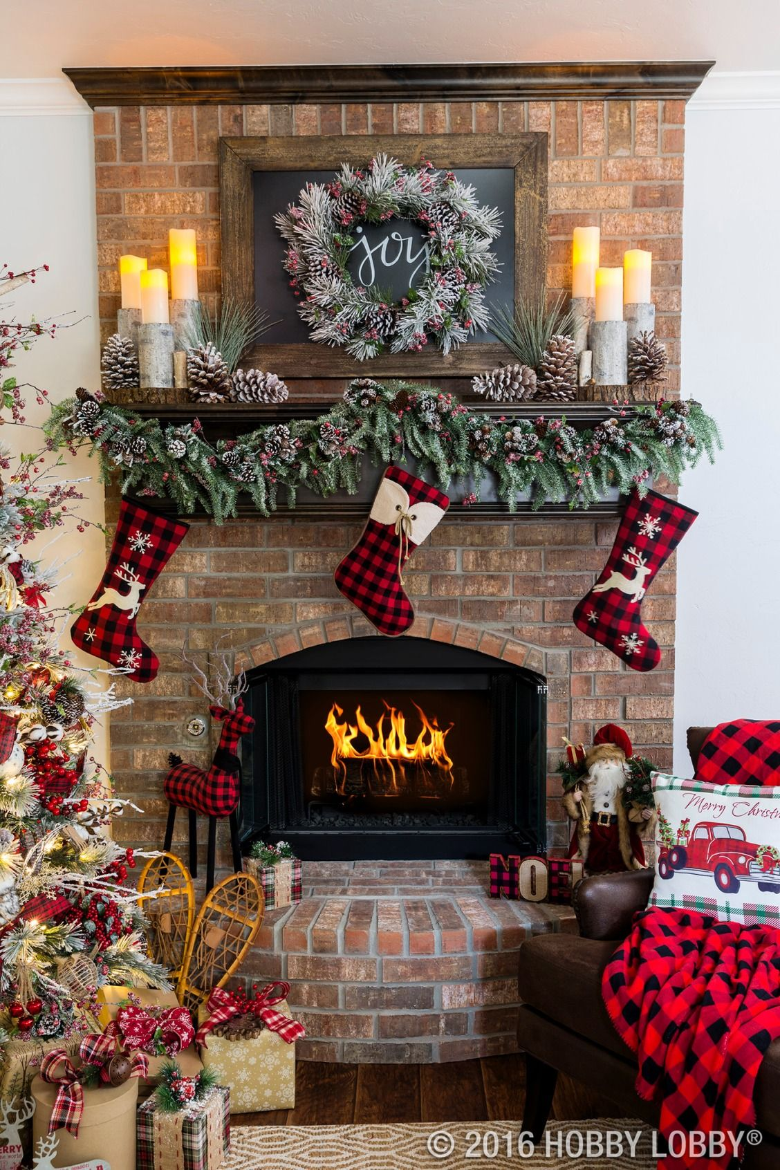 cozy cabin charm meets traditional holiday by coupling warm and rustic accent pieces with elegant christmas decor - How To Decorate A Fireplace For Christmas
