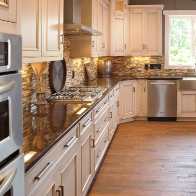 Rustic white cabinets with exposed hinges and stainless