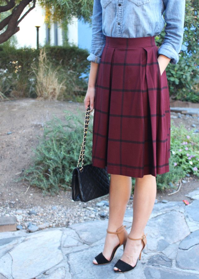 This burgundy windowpane midi skirt is styled by Treats and Trends Blog with a denim button down, black and tan heels, and a classic black leather purse   Banana Republic