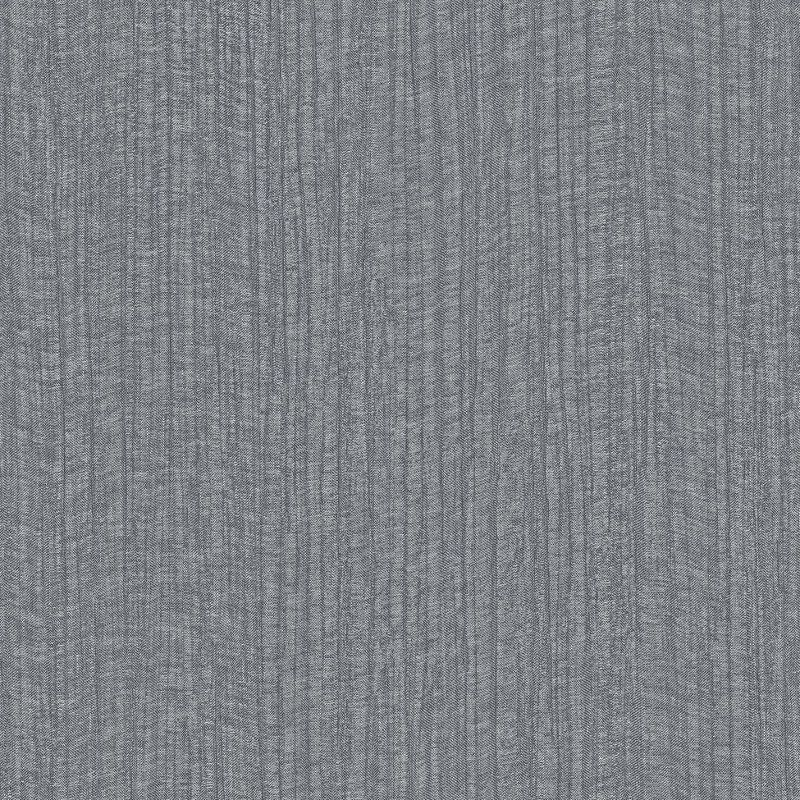 A textured wallpaper in a moody grey colour