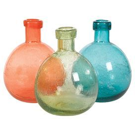 Add a splash of citrus to your living room or bedroom with this spring-ready vase.  Product: 3 Piece vase setConstruction Material: GlassColor: Orange, green and turquoiseDimensions: 10.5 H x 2.5 Diameter each
