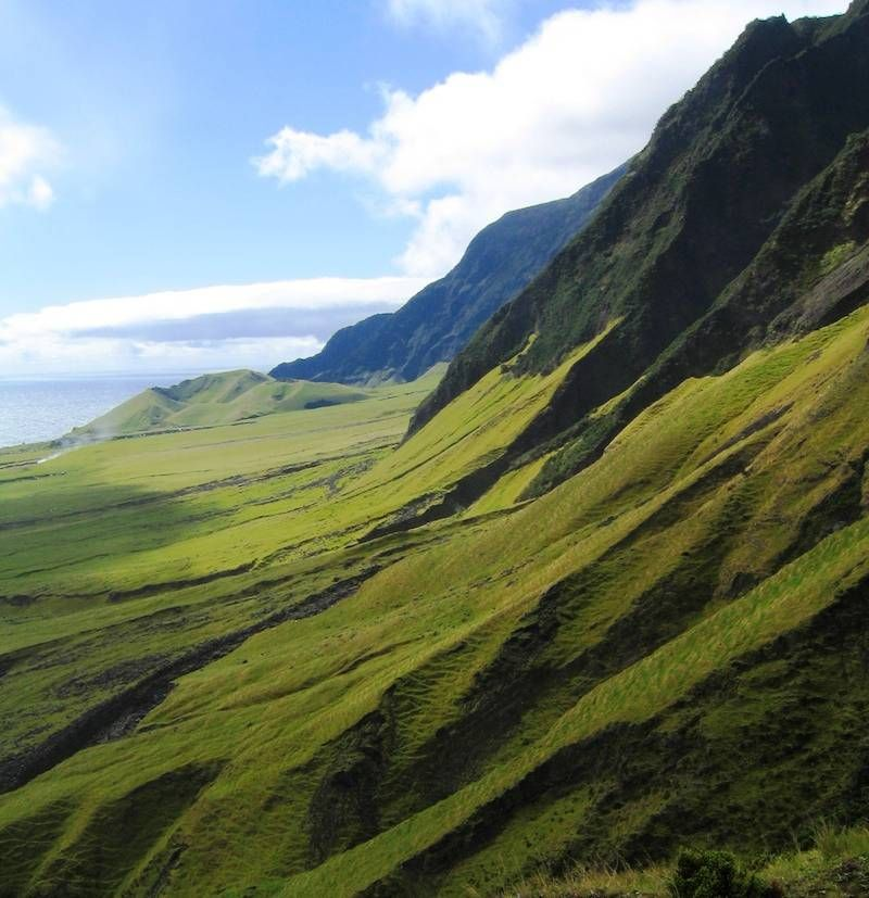 Located in the southern Atlantic Ocean, Tristan de Cunha is an archipelago of small islands considered the most remote place in the world. Surrounded by rocky terrain and choppy waters, the island is only accessible by boat with its closest neighbors, South Africa and South America, 1,700 and 2,000 miles away respectively.