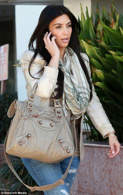 8661ce263 Back in business! The holiday is over as career woman Kim Kardashian  returns to work   Swaggg.   Balenciaga bag, Balenciaga velo, Balenciaga  purse