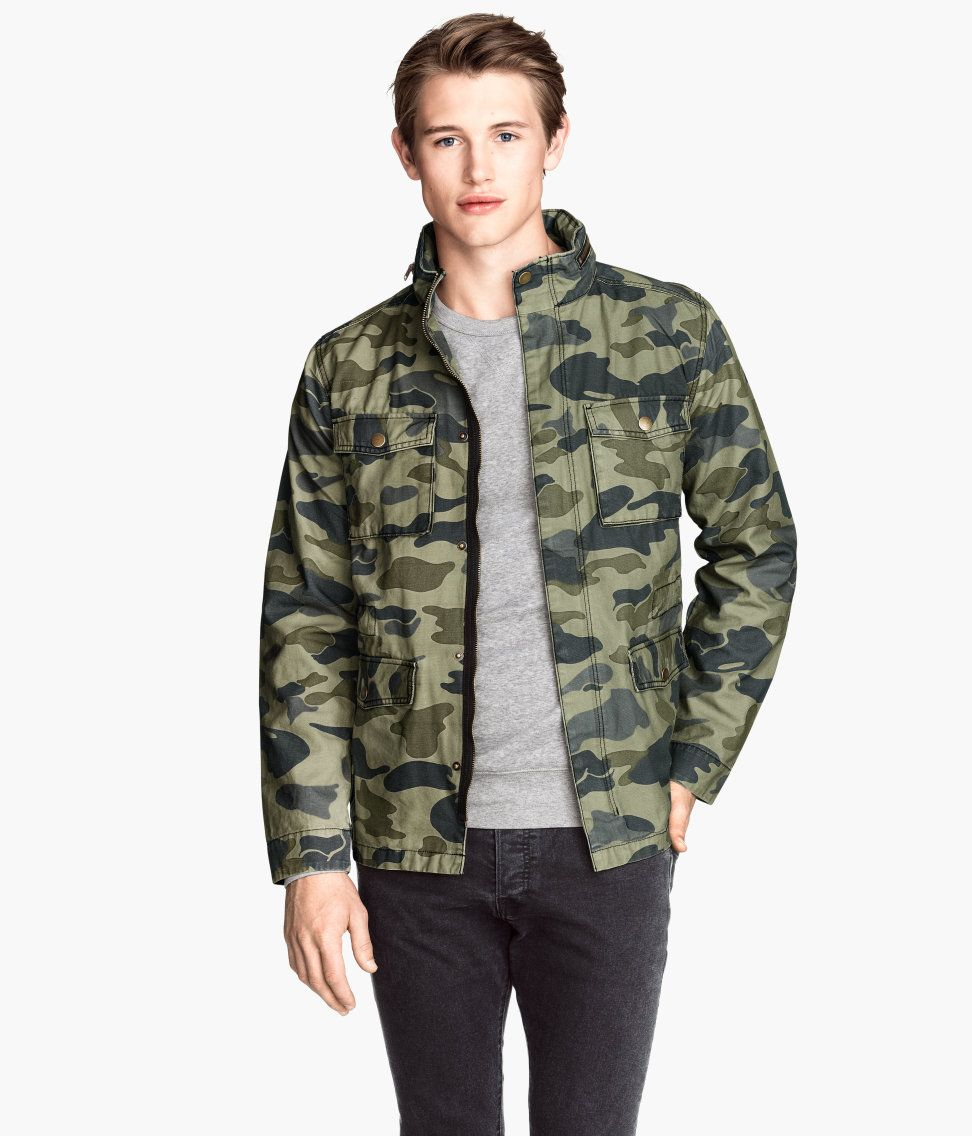 Camo jacket with wind flap, pockets, and hood that folds into ...