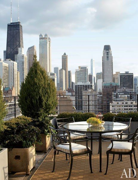 The terrace of a Chicago penthouse offers spectacular skyline views.