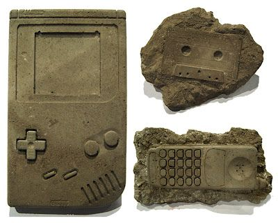Cassettes, Nintendo controllers, Motorola cell phones, Floppy Disks, Sony Walkmans, Boomboxes, 8-Track Tapes and rotary phones are among the cement hand-cast 'modern fossils' by artist Christopher Locke of Austin, Texas. Using a special process, these items-which are given humorous Latin names-are reproduced in a proprietary blend of concrete and other secret ingredients, giving them the look and feel of real stone fossils.