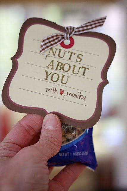 """Nuts About You... i bought a basket from Michaels, got bags of nuts from Costco, made a bow out of ribbon that i had laying around the house, and then printed """"we're nuts about you"""" on cardstock and punched with a heart punch and gave it to my hubby from me and my son for Valentine's Day."""
