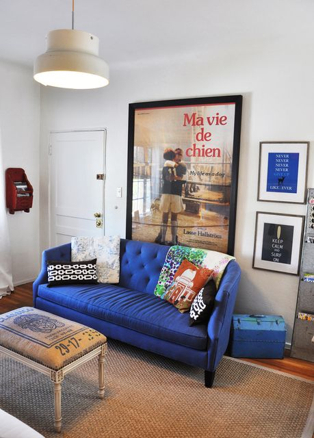 don't be afraid of color- blue sofa in a small livingroom