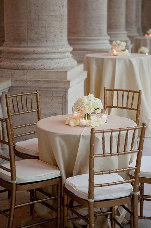 Elegant Low Cocktail Tables, Surrounded By Gold Chiavari Chairs, Are Topped With  White Roses,