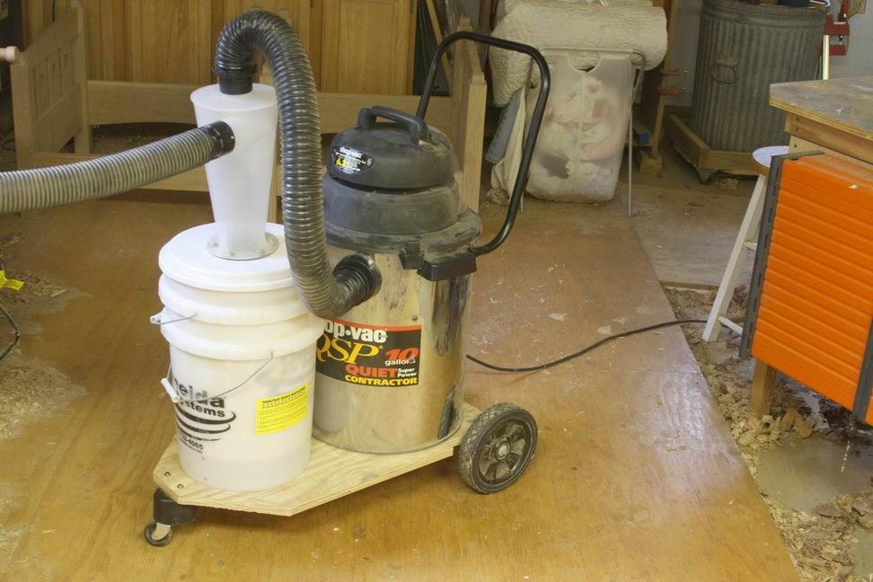 I love Oneida's Dust Deputy. It keeps my shop-vac filter clean and the suction super-strong. But bolted to the side of my vac, it is an awkward appendage. I fixed that problem for good with this simple shopmade cart that marries the two into one nimble unit.