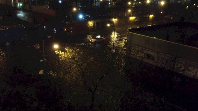 Hurricane Sandy. East Village. New York City. 2012 by Matthew Kraus. 5:30 minutes of footage during the buildup and height of Hurricane Sandy as seen at the corner of 14th street and Avenue C in the East Village of New York City. Aerial shots are from my bedroom window.