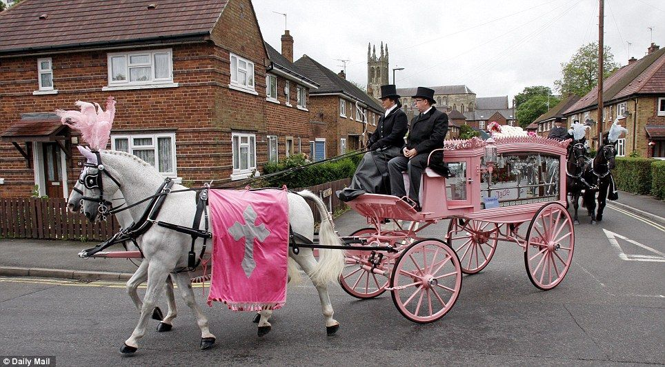 White horses with plumes of pink feathers and pink flags pulled the pink carriage containing Jade's coffin