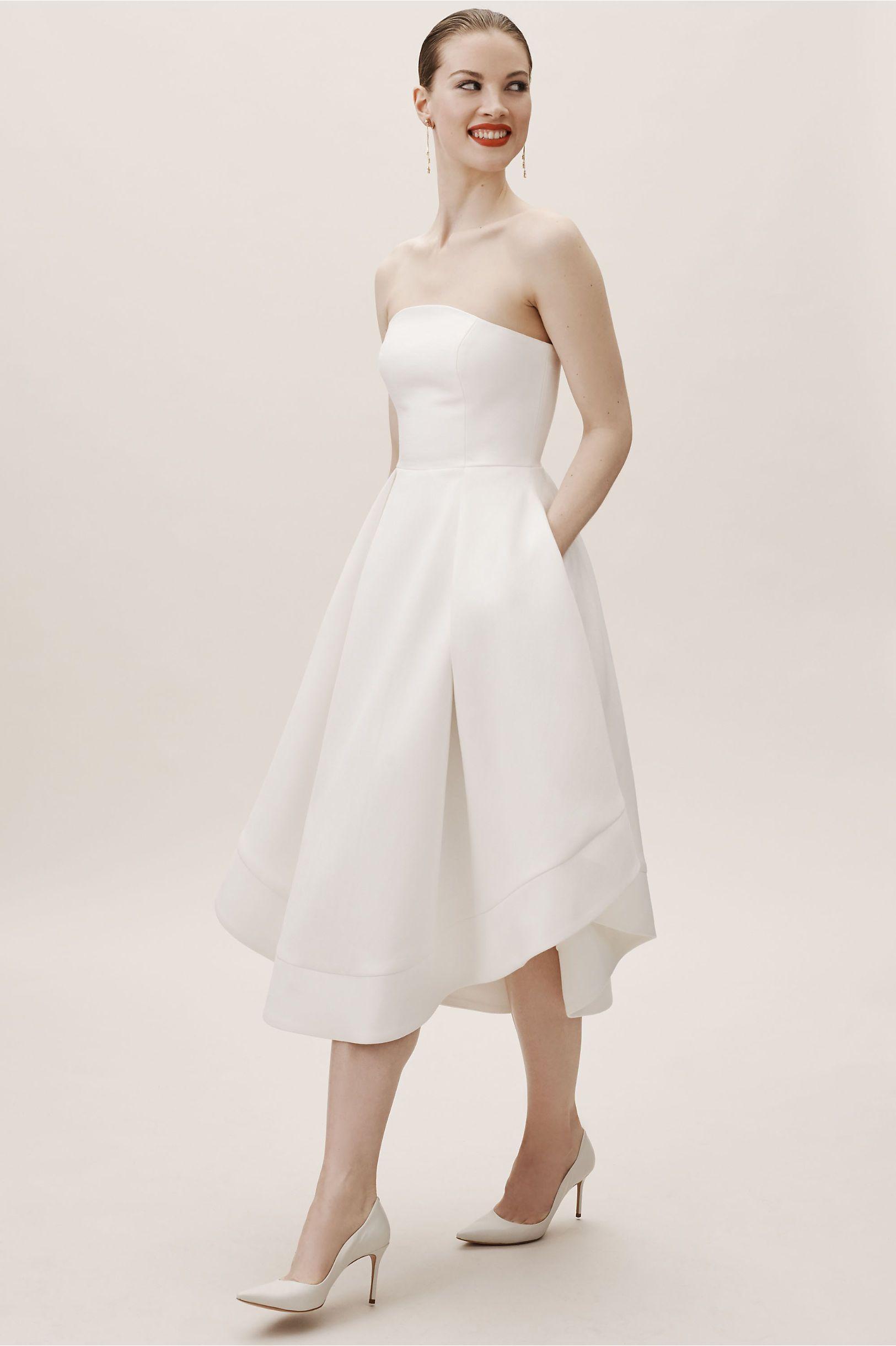 20 Simple Wedding Dresses For Every Budget A Practical Wedding A Line Wedding Dress Tea Length Wedding Dress Pleated Wedding Dresses [ 2440 x 1625 Pixel ]