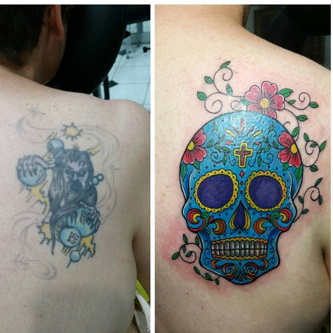 Blue sugar skull tattoo on mans back as a cover up the same as blue sugar skull tattoo on mans back as a cover up the same as above biocorpaavc Images