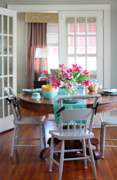 round oak pedestal table with white painted chairs ...