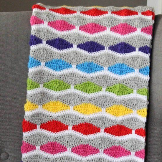 This fun crochet blanket pattern is colorful and modern. A free ...