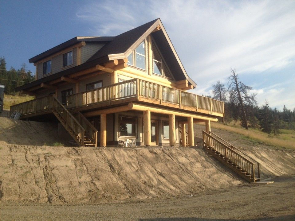Stump lake project features douglas fir trees and a beautiful wrap around deck