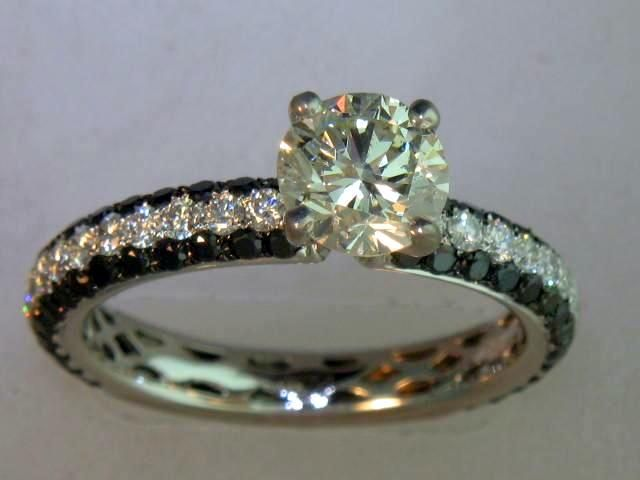 I keep going back to this one. 6 prong, all white diamonds, with 2 small black bands flanking the top and bottom.