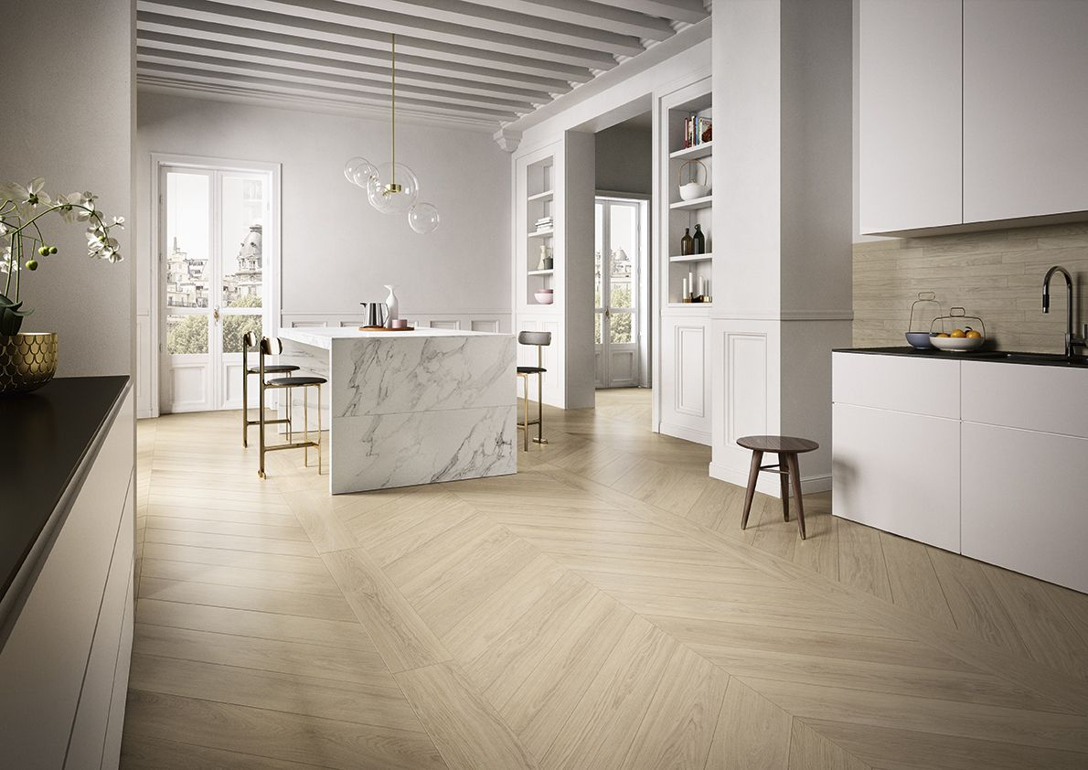 The warmth of the wood and natural elegance to the most precious porcelain in the kitchen and dining room #interiordesign #tile #tiles #piastrelle #white #pavimento #rivestimento #parete #wood #woodeffect #legno #effettolegno