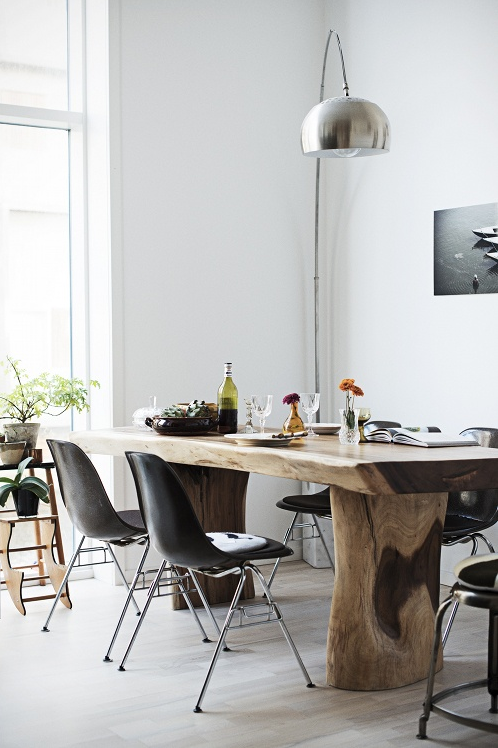 Solid Wood Dining Table With Simple Black Eames Chairs And Arco