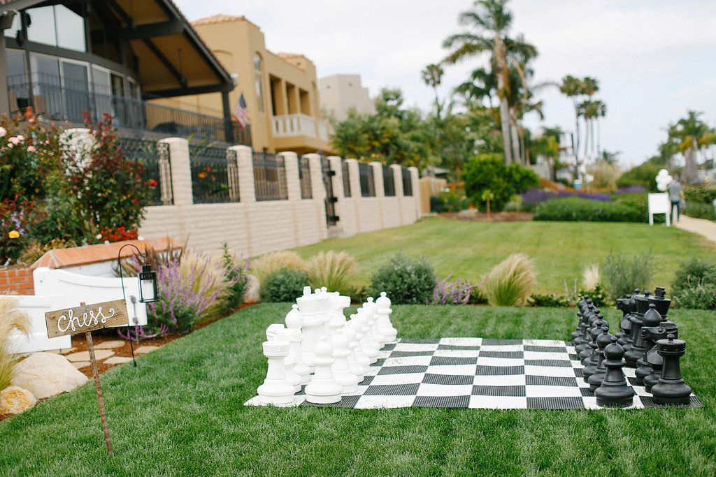 Large Lawn Chess Set | Photography: Luke & Katherine Griffin for Max & Friends. Read More: http://www.insideweddings.com/weddings/tent-wedding-with-chic-nautical-theme-on-la-playa-bay-in-san-diego/737/