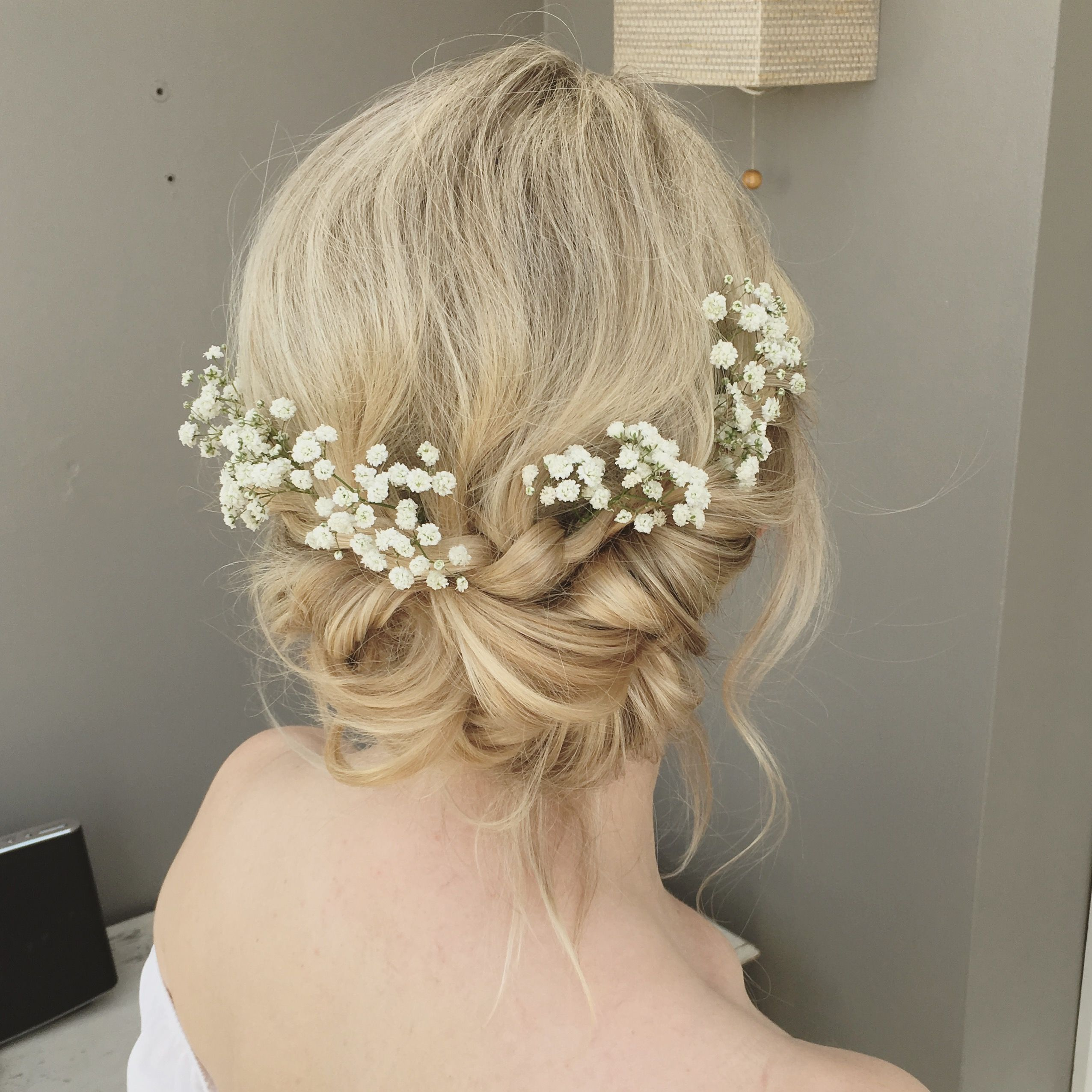 boho messy and relaxed wedding hair with gypsophila and plaits