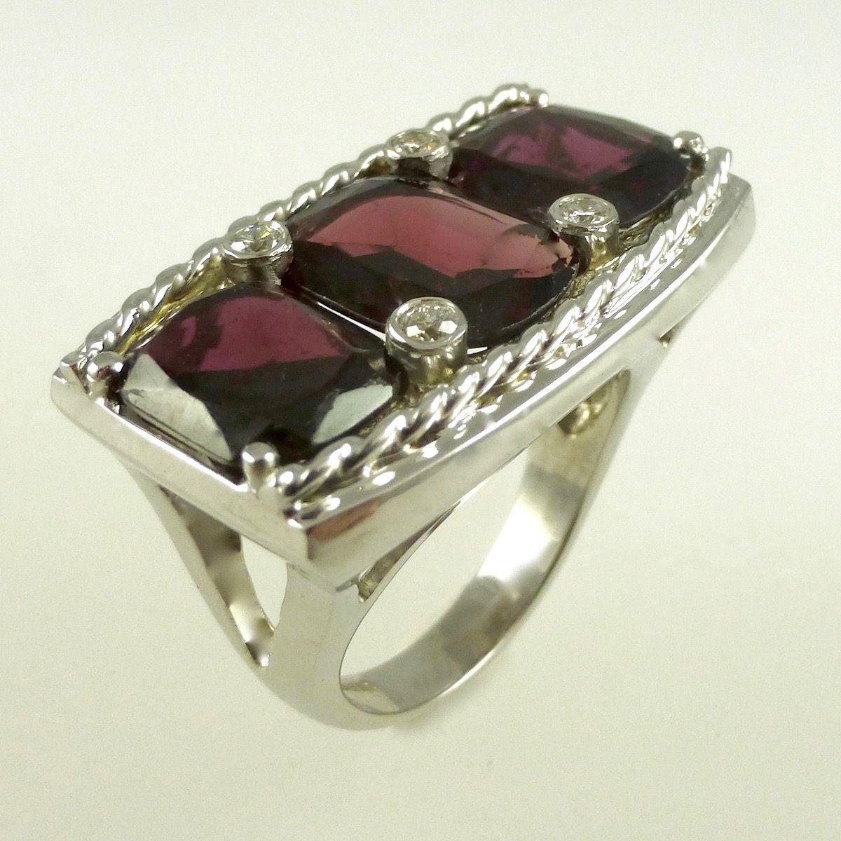 Garnet dress ring set in 18 carat white gold