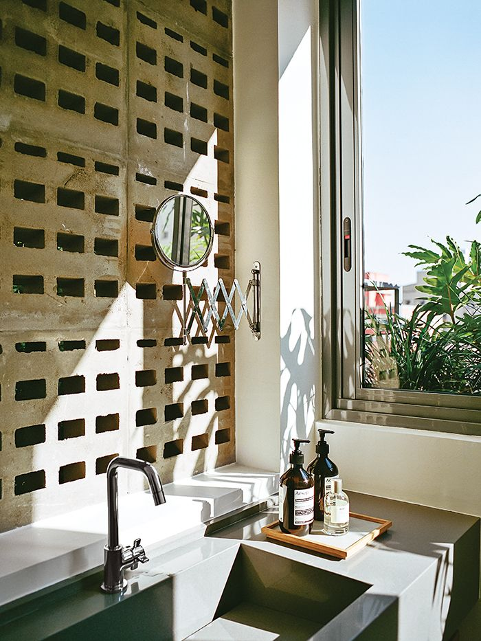 Perforated concrete blocks in the guest bathroom