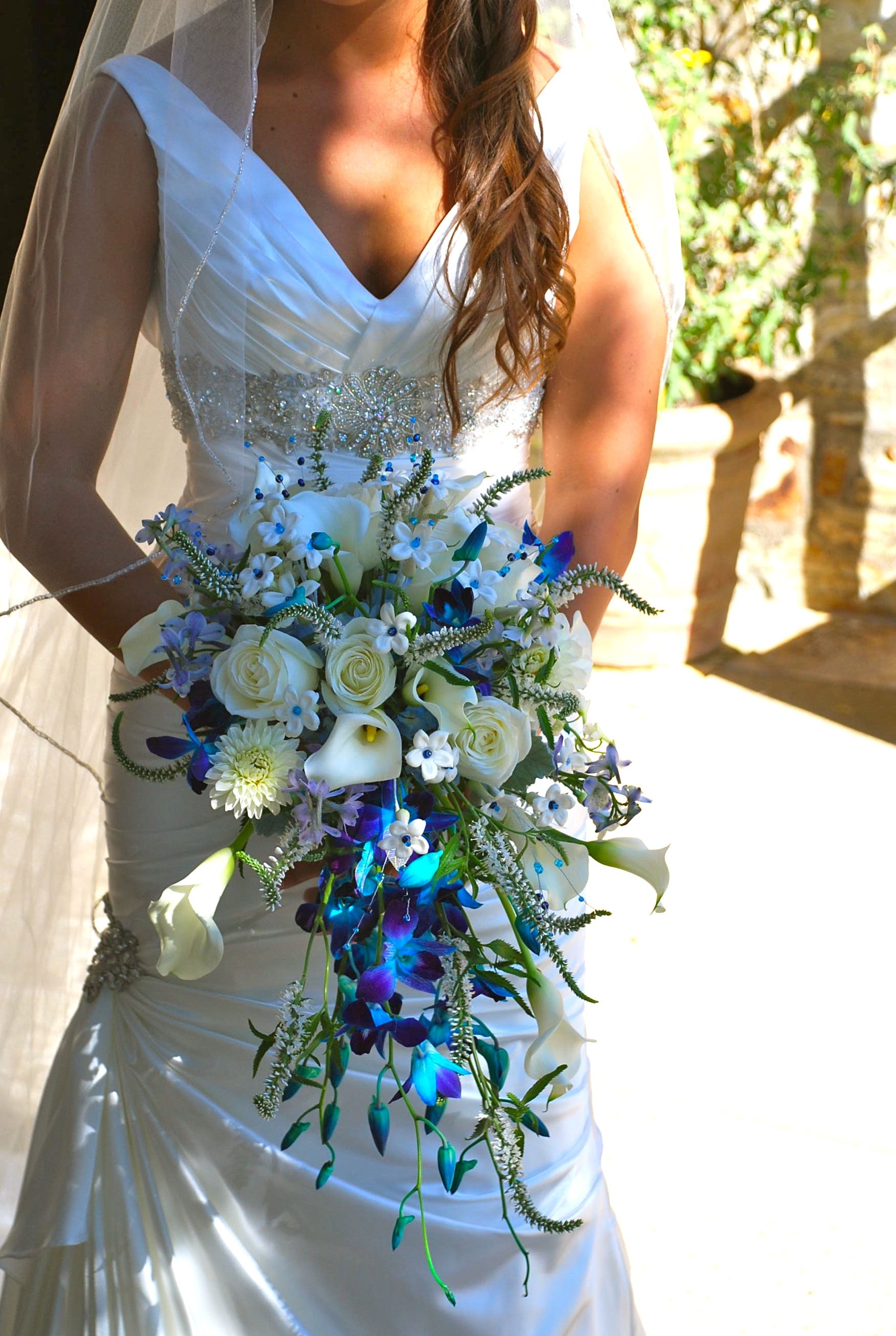 Cascading bouquet with blue orchids, calla lilies, roses