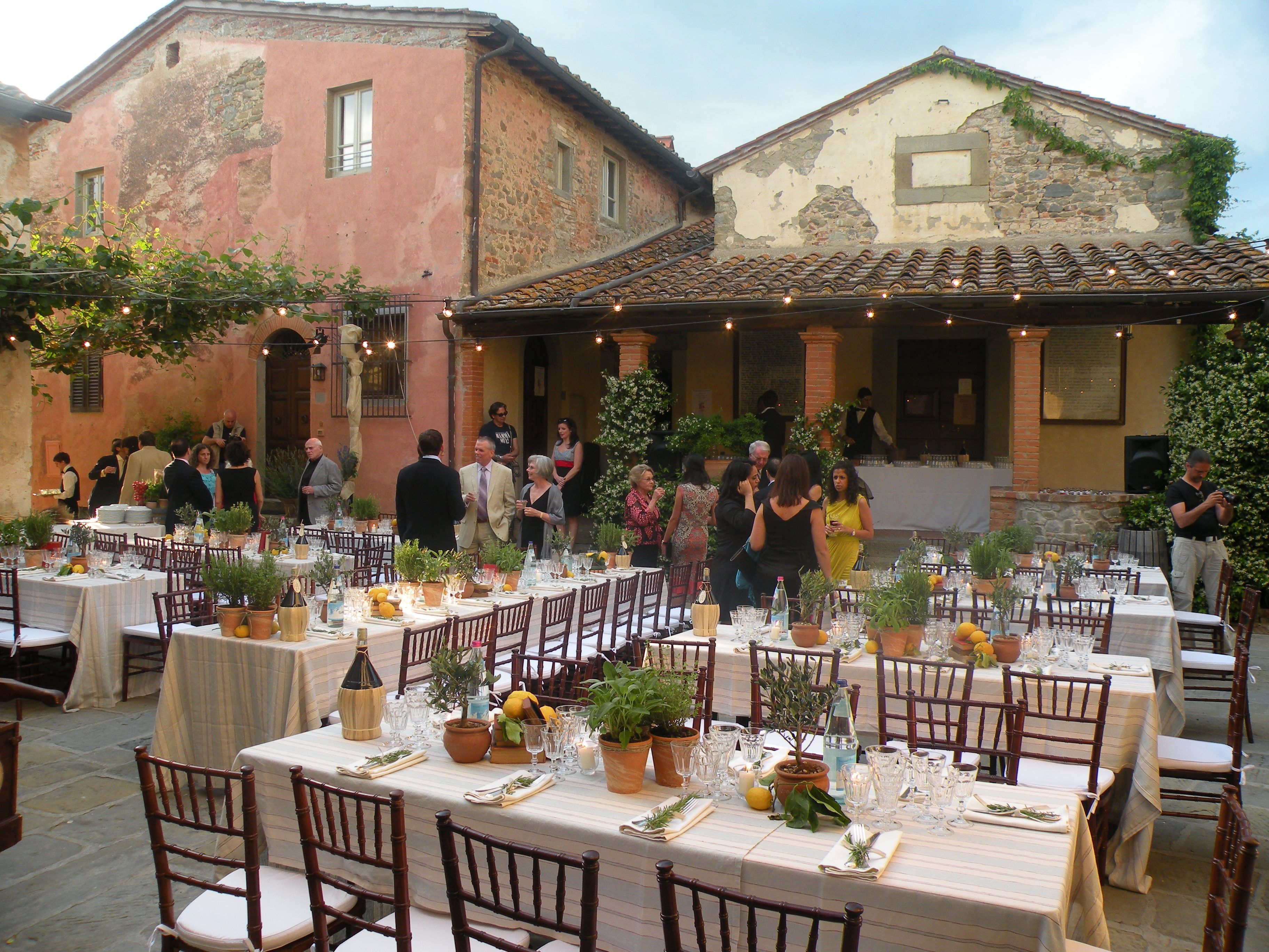 guests start arriving to the rehearsal dinner in the tuscan