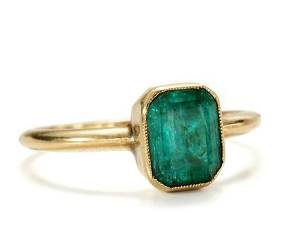 Circa 1859. 18k gold with cushion rectangular cut natural emerald set in a clean bezel with serrated edges. Very simple. Love this ring.
