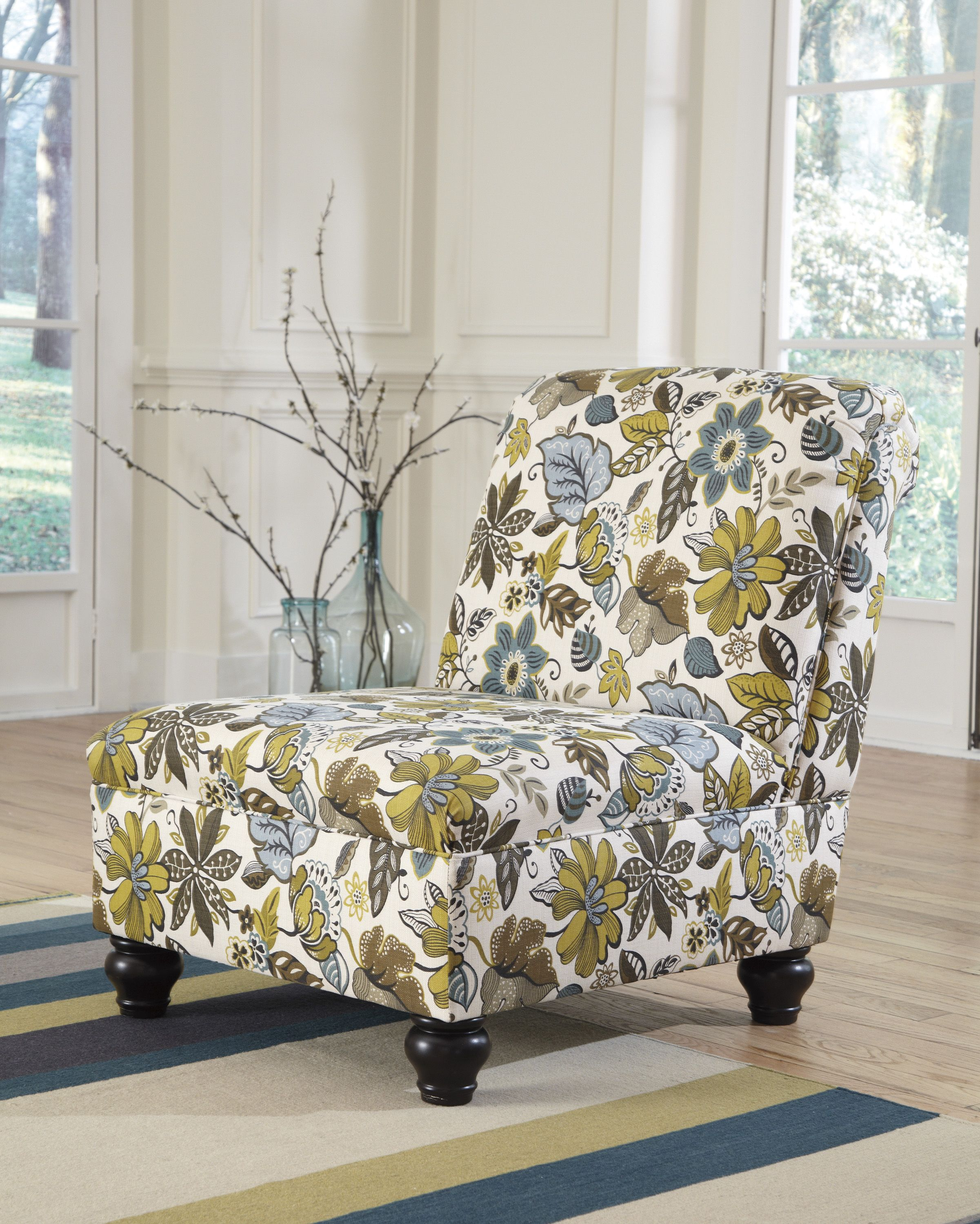 Floral patterned armless chair. Bright and cheery