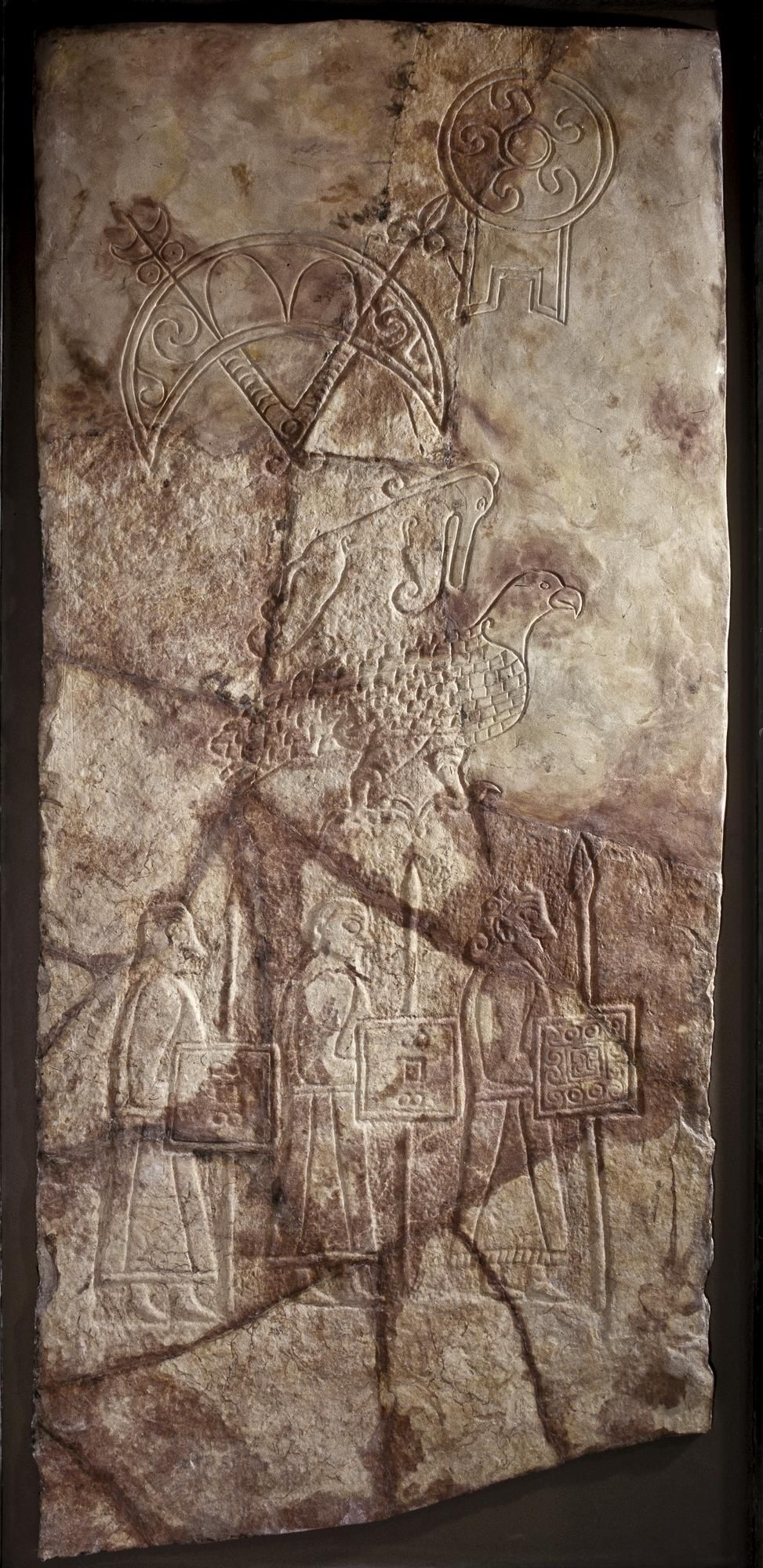 Pictish stone cross slab showing three warriors with coiffed hair and  shaped beards, from Birsay, Orkney, 7th or 8th century.