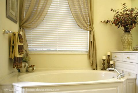 Love the drapes for over the tub would add a sheer cream for Master bathroom curtains