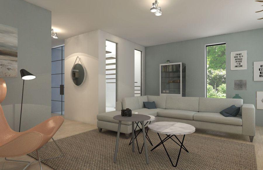 huiskamer met groene muur en hoekbank danielle verhelst