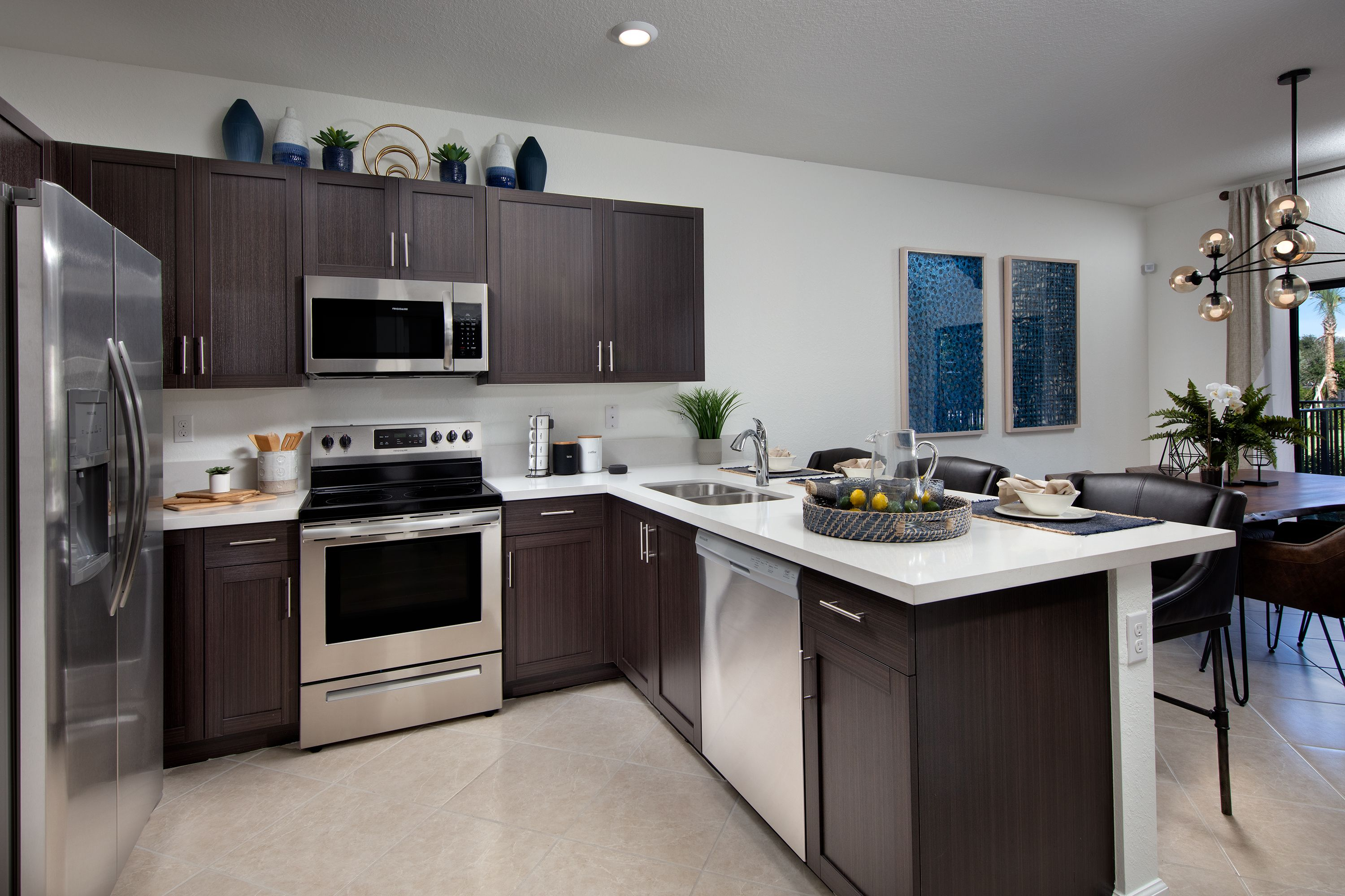 In This Deluxe Kitchen Enjoy A Stainless Steel Appliance Package Contemporary Cabinets In Your Choice Of Designer Dream Kitchen Lennar Contemporary Cabinets