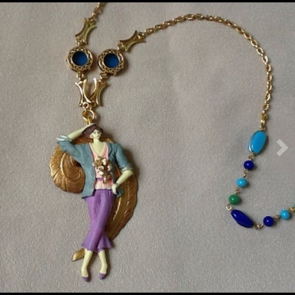 ON SALE!!   Vintage Classy Lady Necklace Stylish vintage lady on a gold feather background hangs from a mix of chain / blue glass / and beads. Lady measures 3-1/2 inches in length and necklace is 28 inches long.  Handcrafted, one-of-a-kind piece! Jewelry Necklaces