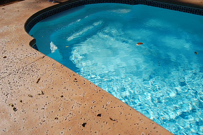 Rock Salt Finish Concrete Pool Deck On Clematis Vines Home Depot Salt Pool Concrete Pool Concrete Stain Patio