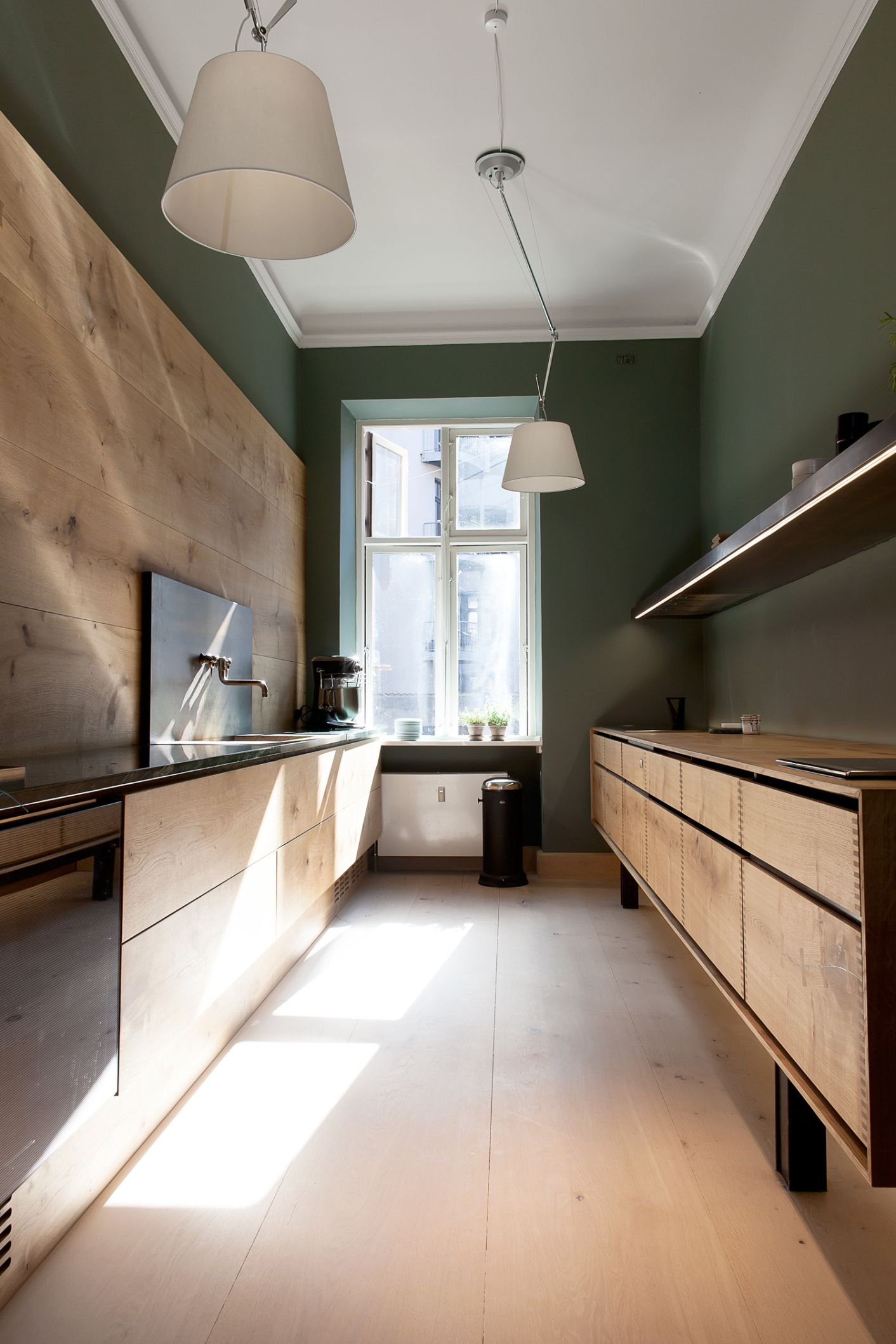 Wood and green kitchen dinesen showroom via cocolapinedesign