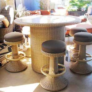 Wicker outdoor table set--a tall table set would go great with a low L-couch if they're both similar styles...