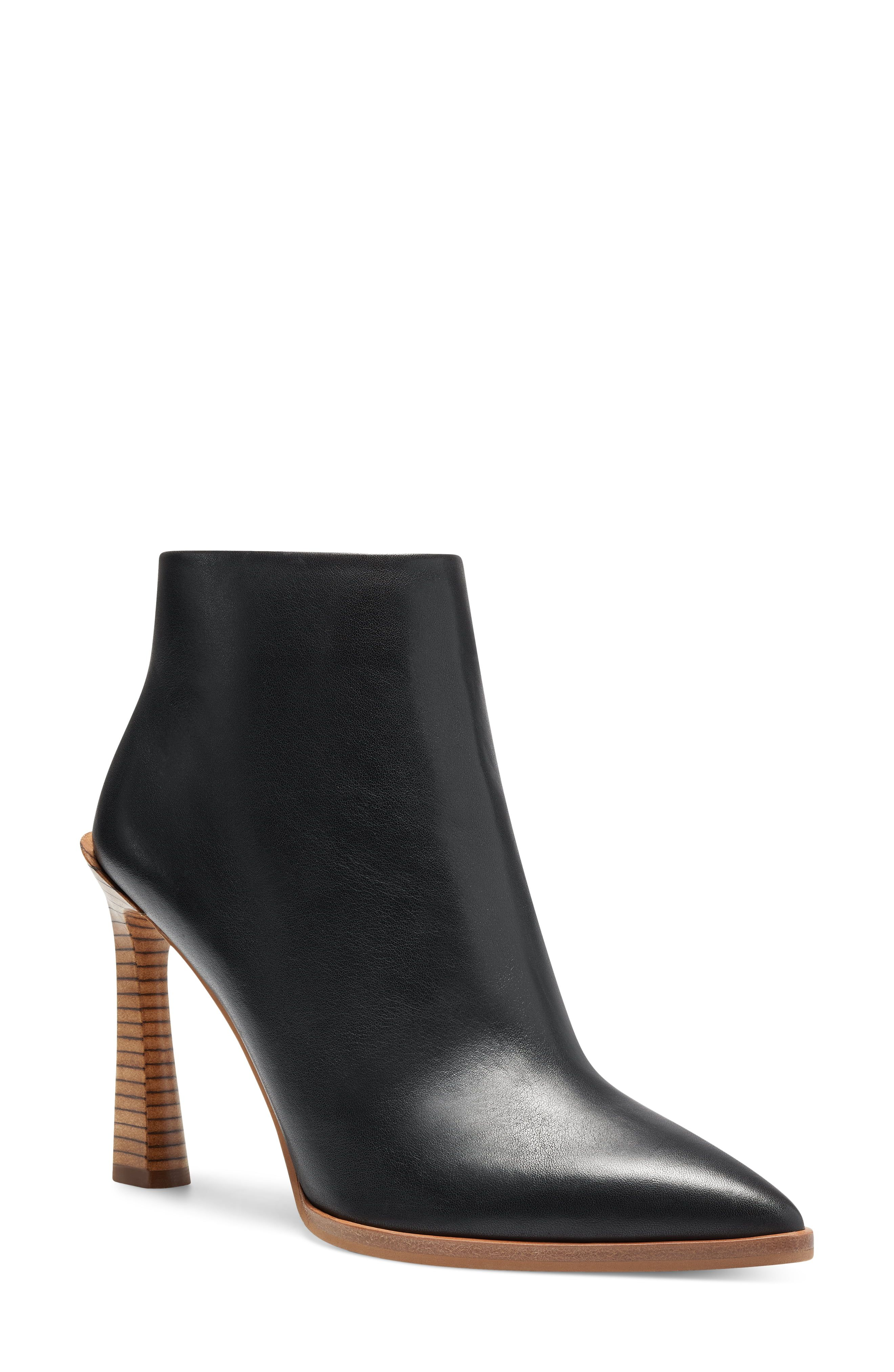 A slightly flared heel adds a sense of modern drama to this sleek pointy-toe bootie. Style Name:Vince Camuto Pezlee Pointed Toe Bootie (Women). Style Number: 6122358. Available in stores.