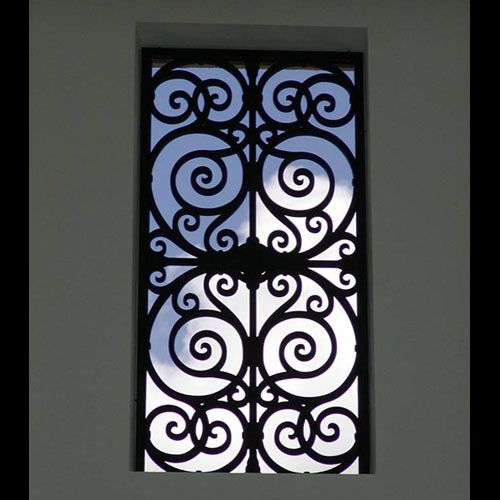 Spanish style wrought iron window grills home design for Fancy window design