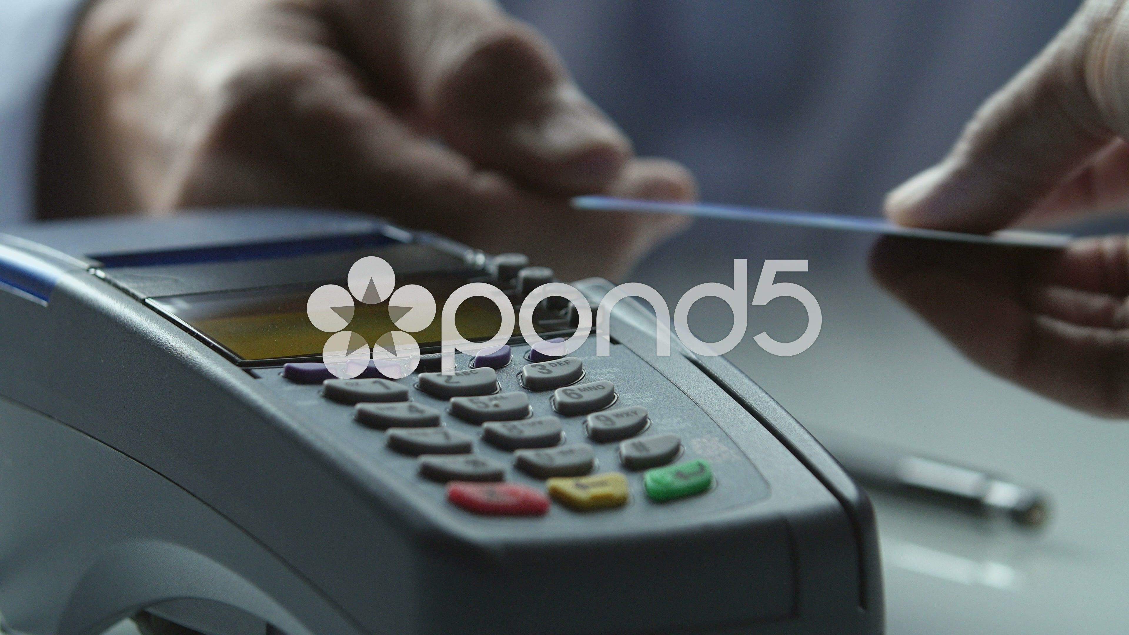 Close up of a credit card scanner processing a card and