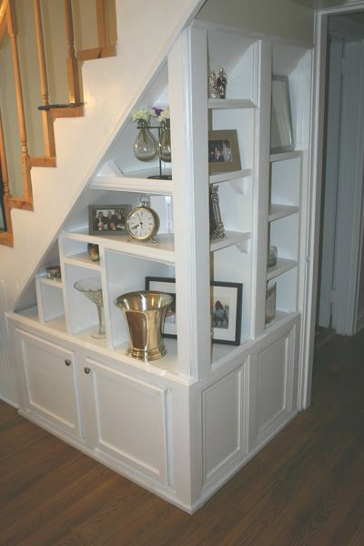 basement stairs storage. Stairwell Built In with display shelves and cabinets underneath  I can t decide if this is a creative use of